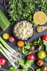 Bowl of Bulgur and ingredients for preparing Tabbouleh - SARF03387