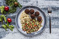 Bulgur wheat salad, Hummus and Falafel on plate - SARF03390