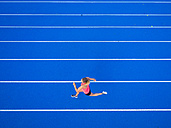 Top view of female runner on tartan track - STSF01334