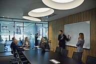 Businessman leading a presentation during a  meeting - ZEDF00915