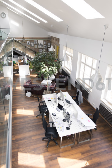 Desks with PCs in bright and modern open space office - FKF02635