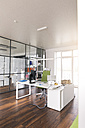 White desk with PC in modern office - FKF02662