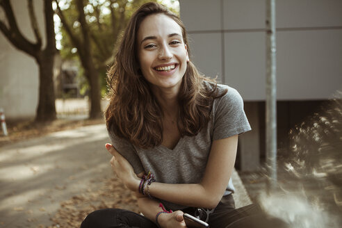 Portrait of happy young woman outdoors - FEXF00302