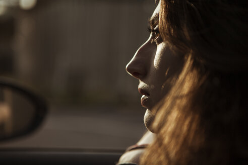 Serious young woman in car - FEXF00308