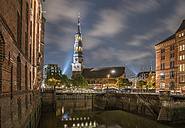 Germany, Hamburg, Speicherstadt, St. Catherine's Church in the evening - PVCF01102