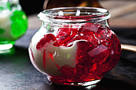 Red fruit jelly in a glass with vanilla sauce - CSF28397
