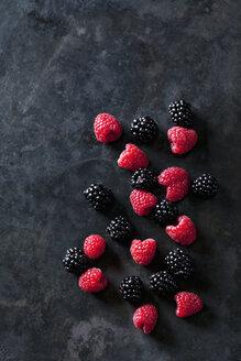 Blackberries and raspberries on dark background - CSF28406