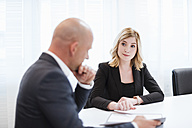 Businessman and businesswoman in conference room - DIGF03088