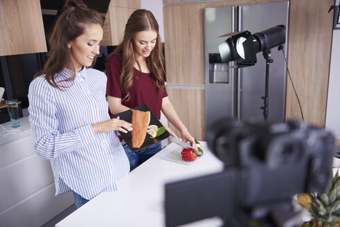 Camera filming bloggers while cooking - ABIF00029