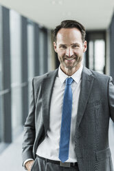 Portrait of smiling businessman - UUF12104