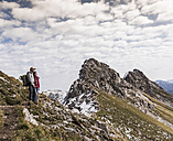 Germany, Bavaria, Oberstdorf, two hikers in alpine scenery - UUF12123