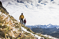 Germany, Bavaria, Oberstdorf, two hikers walking in alpine scenery - UUF12141