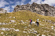 Germany, Bavaria, Oberstdorf, two hikers walking up alpine meadow - UUF12147
