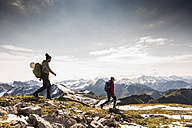 Germany, Bavaria, Oberstdorf, two hikers walking in alpine scenery - UUF12162