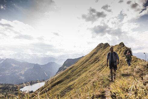 Germany, Bavaria, Oberstdorf, two hikers walking on mountain ridge - UUF12186
