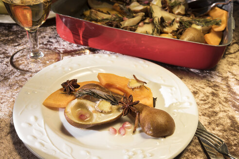 Dish of vegan oven vegetables with pumpkin, pears and spices in roasting tray - CSTF01411