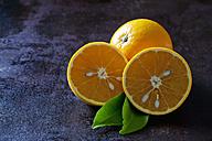 Organic oranges in halves on dark background - CSF28473