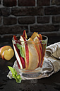 Glass of detox water with sliced red apple and mint - CSTF01416