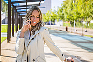 Portrait of businesswoman on the phone - MGIF00179