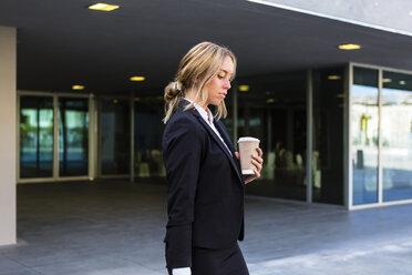 Businesswoman with coffee to go - MGIF00182