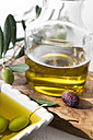 Fresh olive oil in bowl and olives - CSTF01451