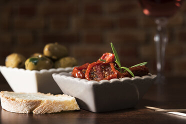 Antipasti, pickled olives, pickled tried tomato, olive bread - CSTF01454