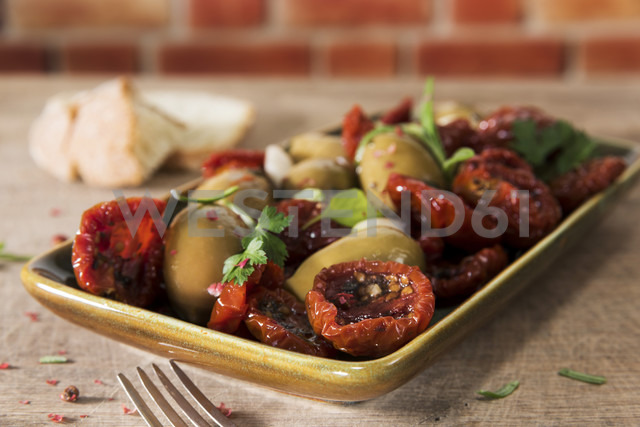 Antipasti, pickled olives and tried tomato, parsley, rosemary, red pepper and olive bread - CSTF01457