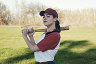 Portrait of young woman with baseball bat in park - RTBF01082