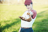 Portrait of young woman with ball and baseball glove - RTBF01097