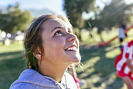 Portrait of laughing girl looking up - MGOF03656