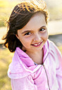Portrait of smiling little girl with blowing hair - MGOF03671