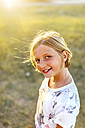 Portrait of smiling blond girl at backlight - MGOF03686