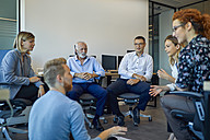 Business team having a workshop in office - ZEDF00951