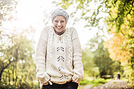 Portrait of happy woman in the forest in autumn - MOEF00257