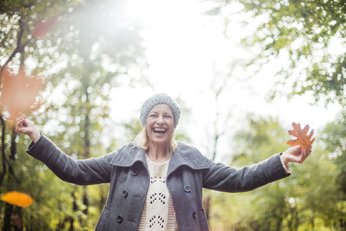 Portrait of happy woman in the forest in autumn - MOEF00260