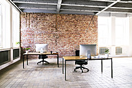 Coworking space with brick wall in office - HAPF02333