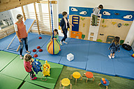 Pre-school teachers and children in gym room in kindergarten - MFF04056