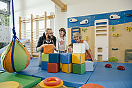 Happy children and teachers in gym room in kindergarten - MFF04059