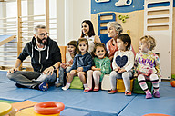 Group of children and teachers in gym room in kindergarten - MFF04062