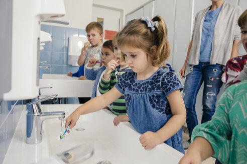 Children brushing their teeth in bathroom of a kindergarten - MFF04101