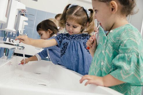 Children brushing their teeth in bathroom of a kindergarten - MFF04104