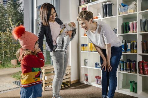 Mother with two children and pre-school teacher in kindergarten - MFF04122