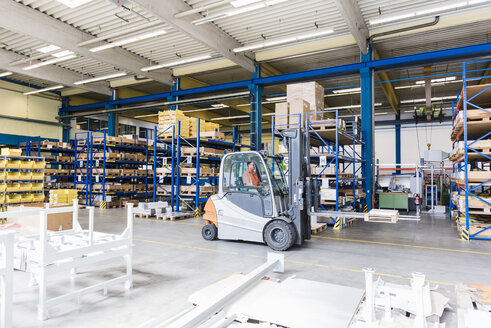Man on forklift in factory warehouse - DIGF03167