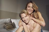 Portrait of happy couple in love in bedroom - PNEF00252