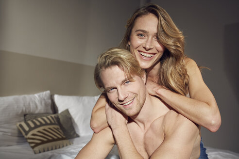 Portrait of happy couple in love in bedroom - PNEF00252