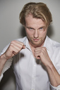 Portrait of  blond young man boxing - PNEF00276