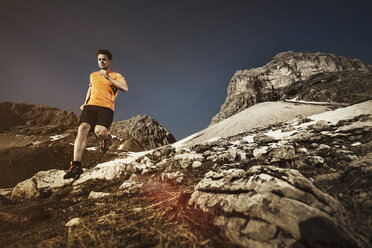 Germany, Allgaeu Alps, man running on mountain trail - MALF00011