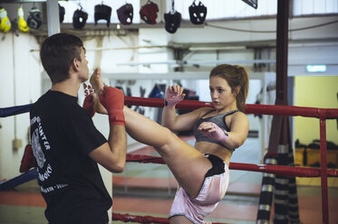 Female martial artist sparring with coach - FRF00606