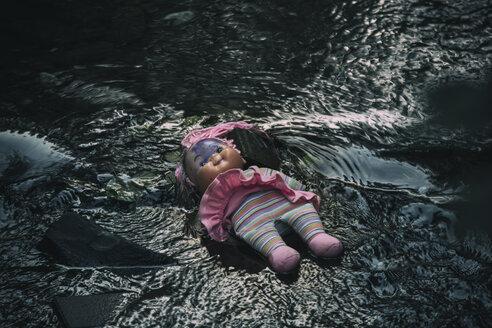 Doll lying in brook - REAF00262