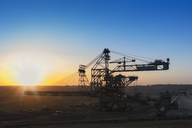 Germany, North Rhine-Westphalia, Juechen, Garzweiler surface mine, Stacker during repair at sunset - FRF00614